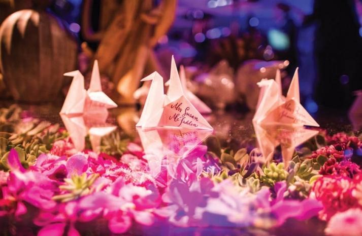 Modern wedding reception with paper crane escort cards