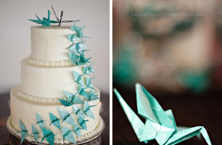 aqua origami cranes cascading on classic wedding cake