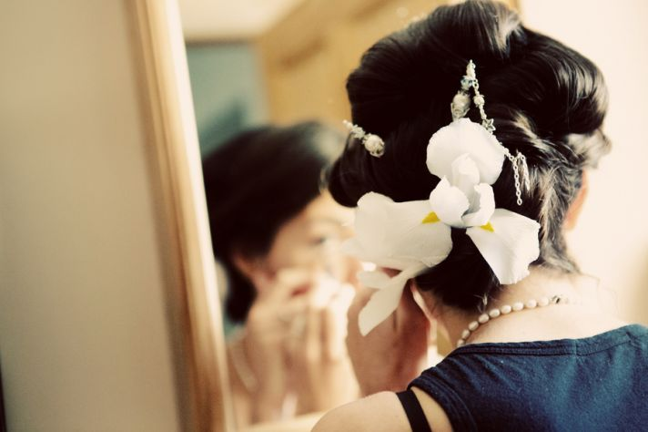 wedding updo finished with orchids and stands of pearls