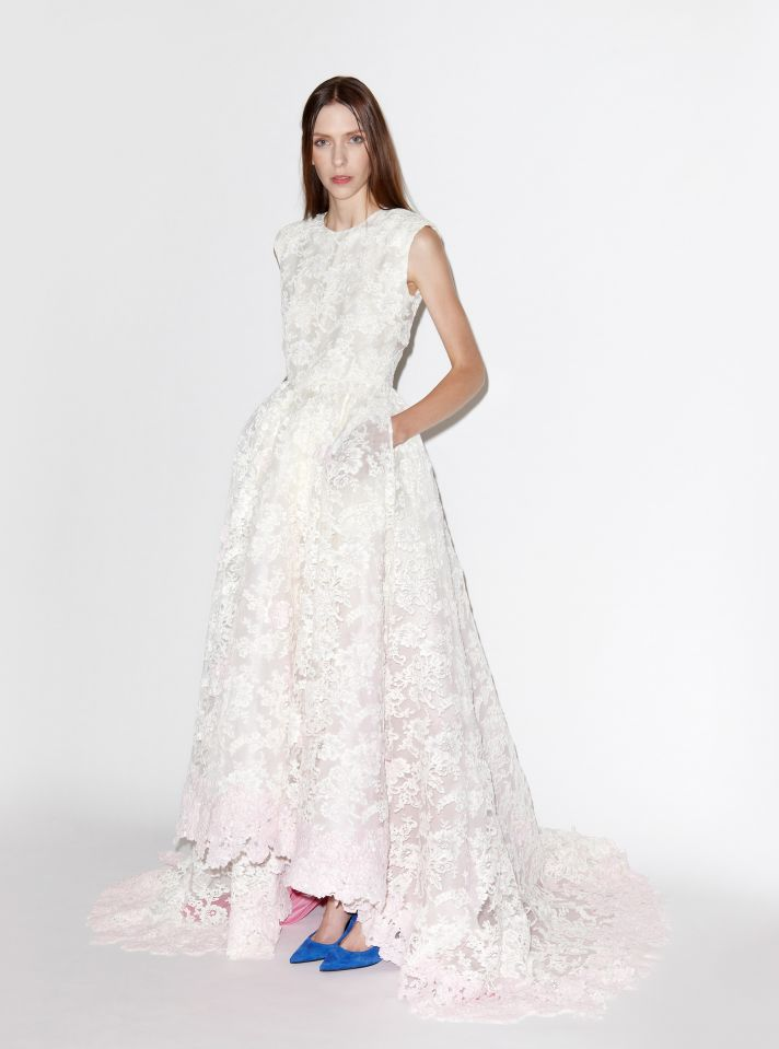Lace wedding dress with pale pink underlay