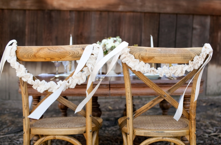 ruffled wedding chair decor for the bride and groom