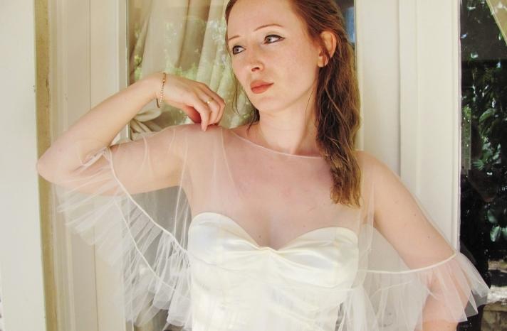 sheer bridal cape with ruffled trim