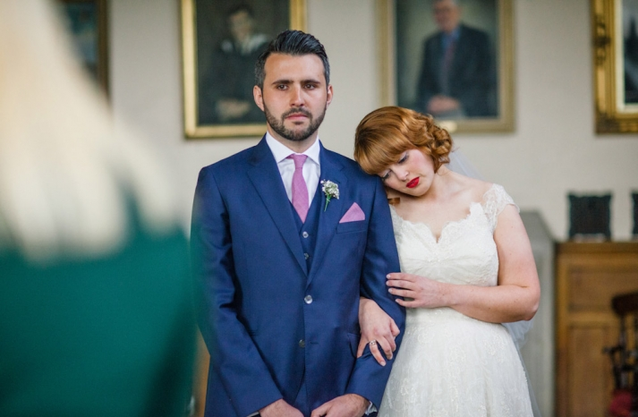bright navy grooms suit with pink tie and pocket square