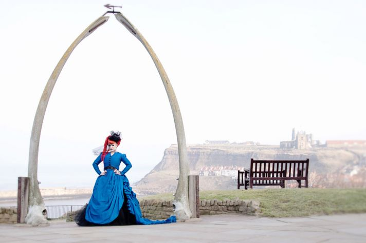 gothic victorian bride wears blue corseted gown