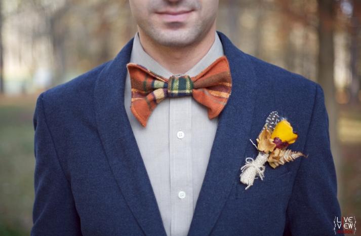 rustic groom wears stylish plaid bow tie