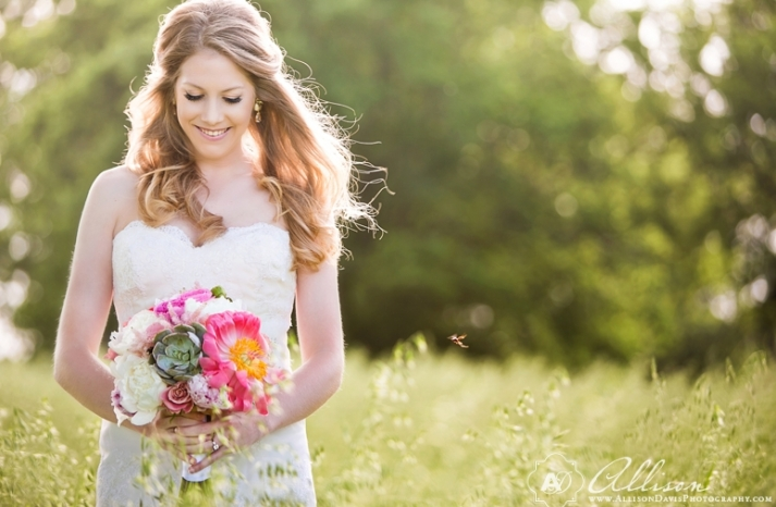 classic romantic bride wears wavy half up hairstyle and natural makeup