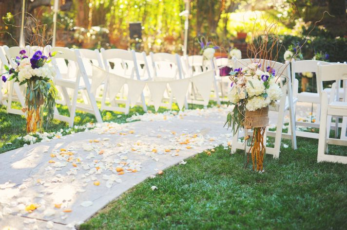 Outdoor ceremony aisle with flower petals
