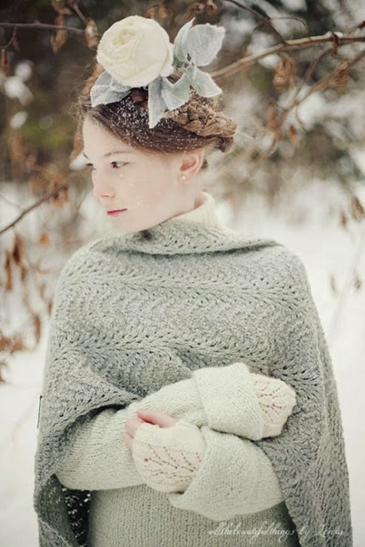 Winter bride with a large flower headpiece