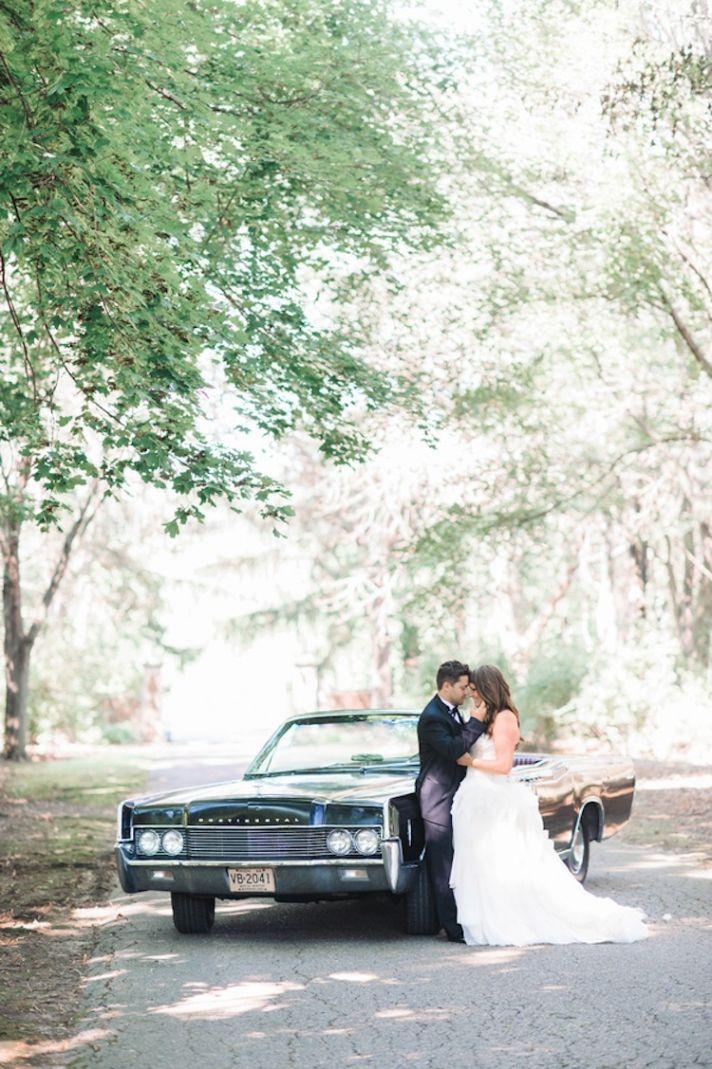 Real bride and groom by getaway car