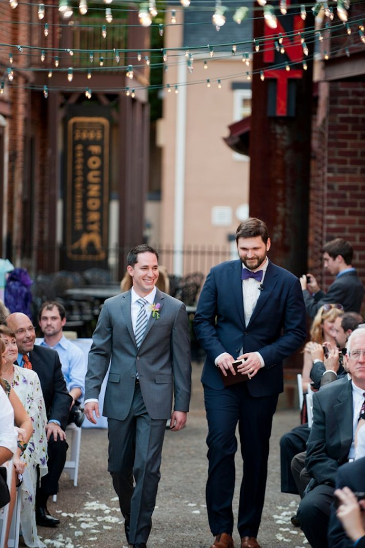 Groom and pastor walk down the aisle