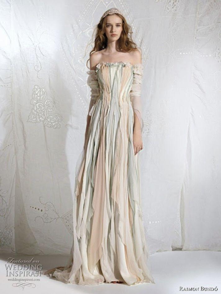 Gown by Raimon Bundo via Wedding Inspirasi