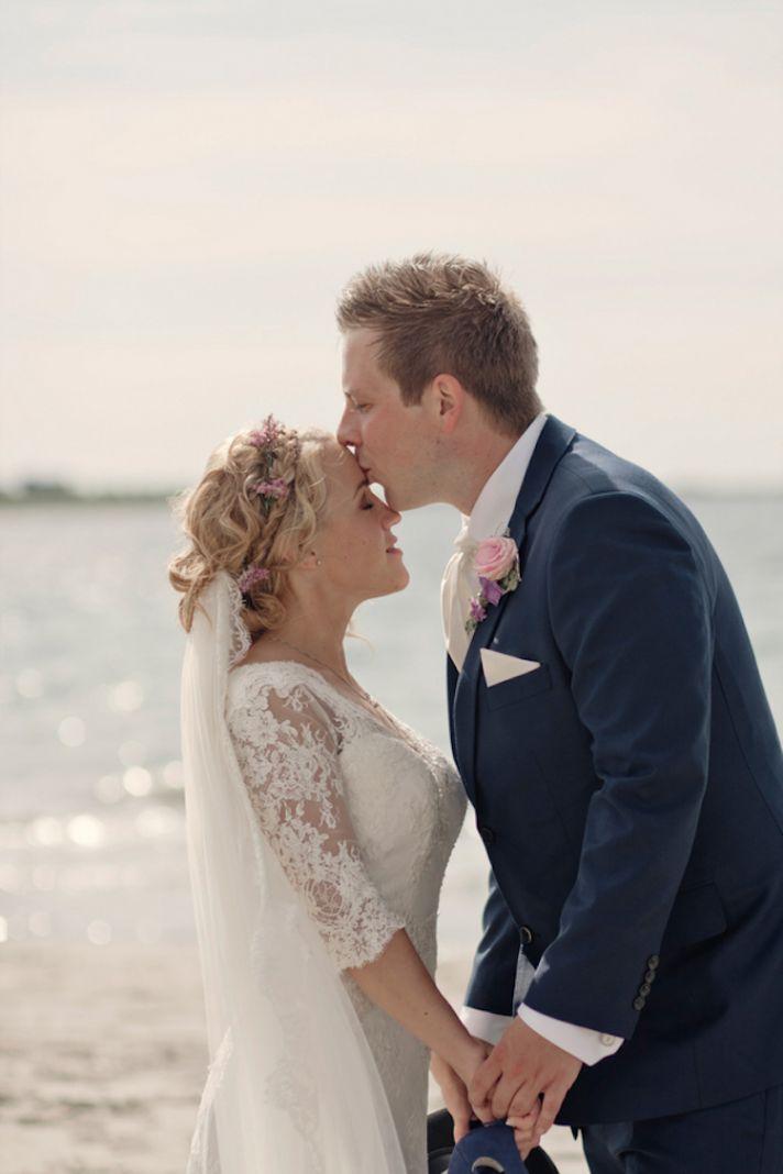Beach real wedding kiss