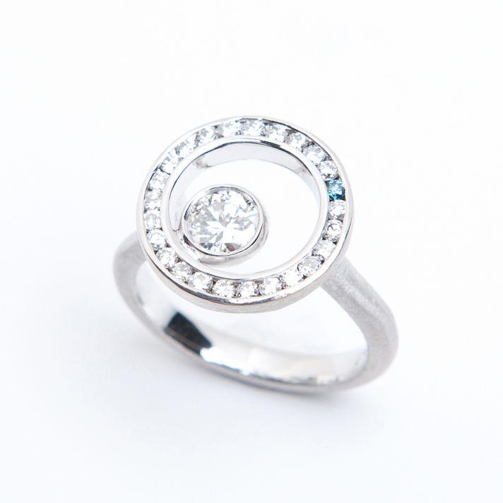 Unique white gold diamond engagement ring