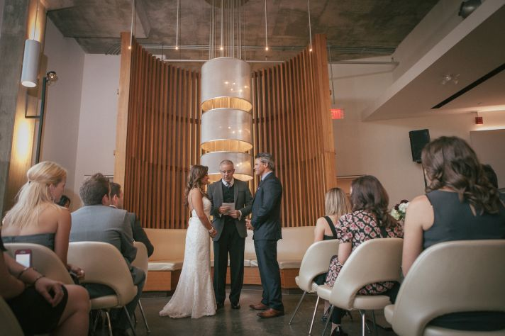 Bride and groom at indoor ceremony